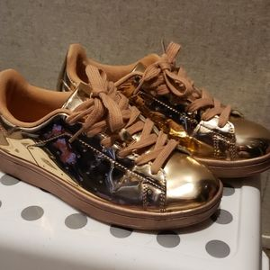 Gold rose tennis shoes